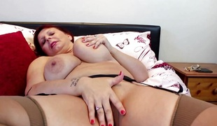 Large breasted British lady fooling around