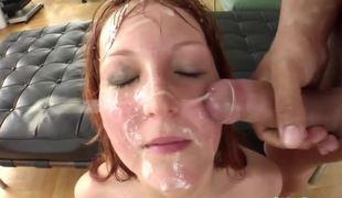 Lusty redhead sucks on multiple rods